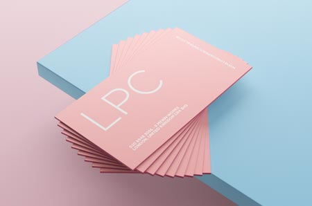 Pink business card on blue background